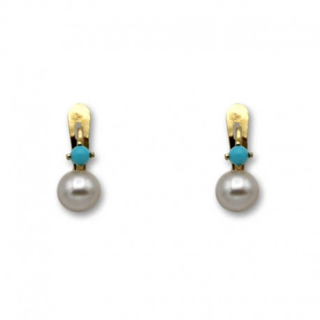 Pendiente de oro garra turquesa y perla 1ª postura