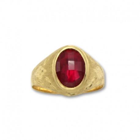 Sello de oro ovalado con tallas y rubí